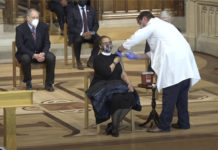 """Rev. Patricia Hailes Fears receives the first COVID-19 vaccine at the White House """"vaccine confidence event"""" at the Washington National Cathedral in Washington, D.C."""