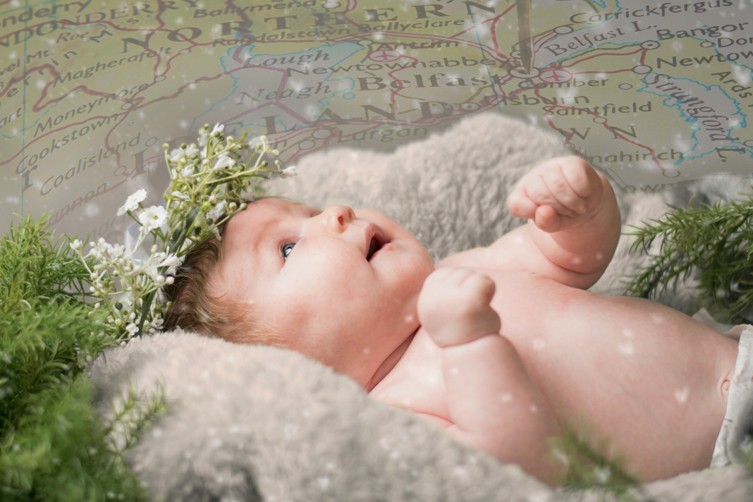 Baby with green map of Northern Ireland