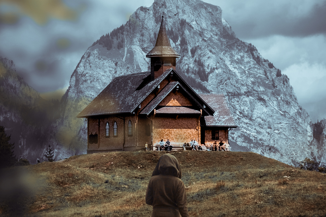 Woman walking with a church in the background
