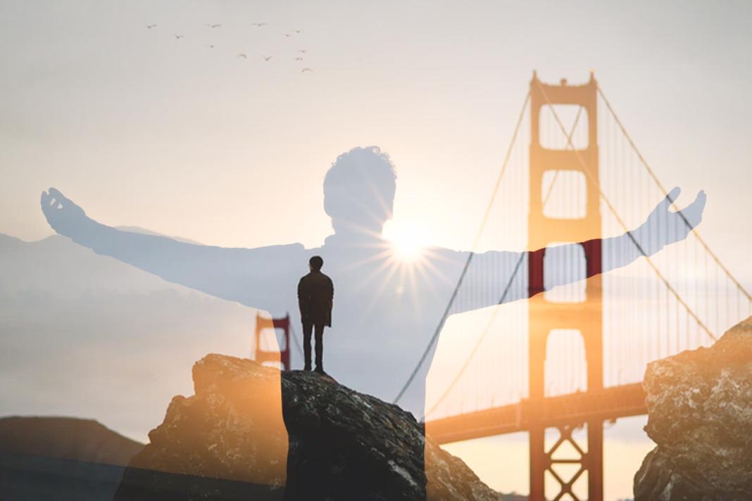 man standing near golden gate bridge