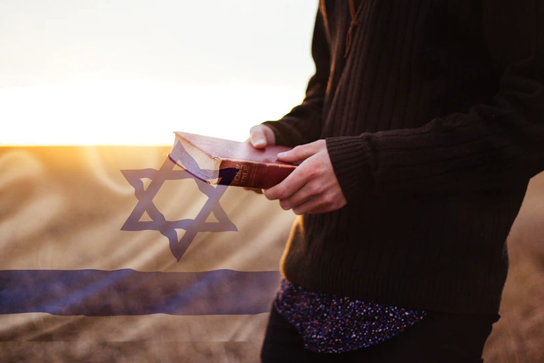 Person with Bible and Israel Flag