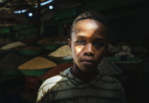 Kid sells In the middle of a market, this child stands inside the spice market to work with his father Souq Omdurman - Khartoum - Sudan