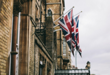 Flags on the side of a building in Oxford, United Kingdom