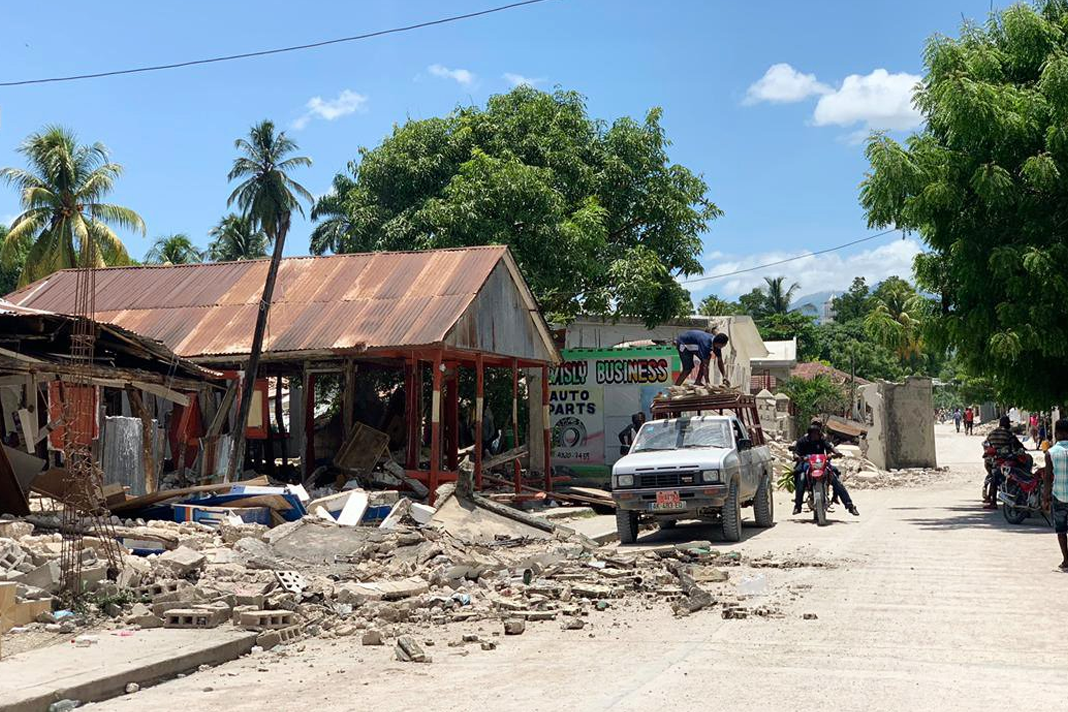Haitians salvage what they can from homes and businesses that were destroyed by the earthquake. (Mission of Hope)