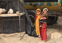 Girl holding her sister in Afghanistan